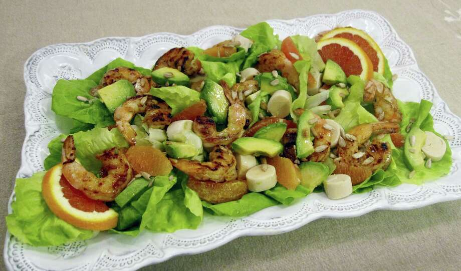 A salad of spicy grilled shrimp with hearts of palm, avocado and orange. Photo: Sara Moulton Via AP   / Sara Moulton