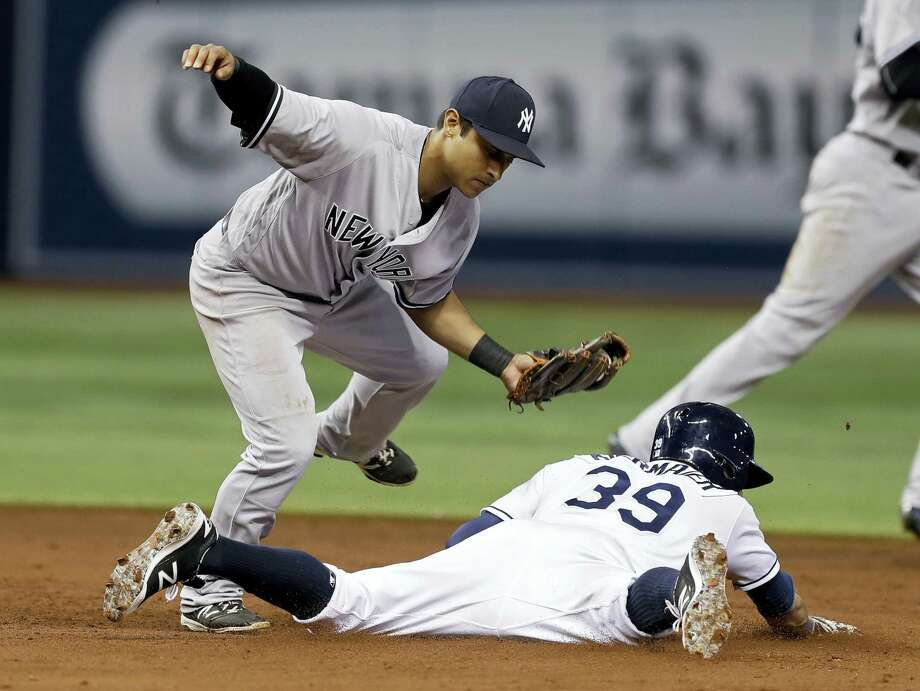 Yankees second baseman Donovan Solano tags out the Rays' Kevin Kiermaier attempting to steal second base during the third inning Thursday. Photo: Chris O'Meara — The Associated Press   / Copyright 2016 The Associated Press. All rights reserved.