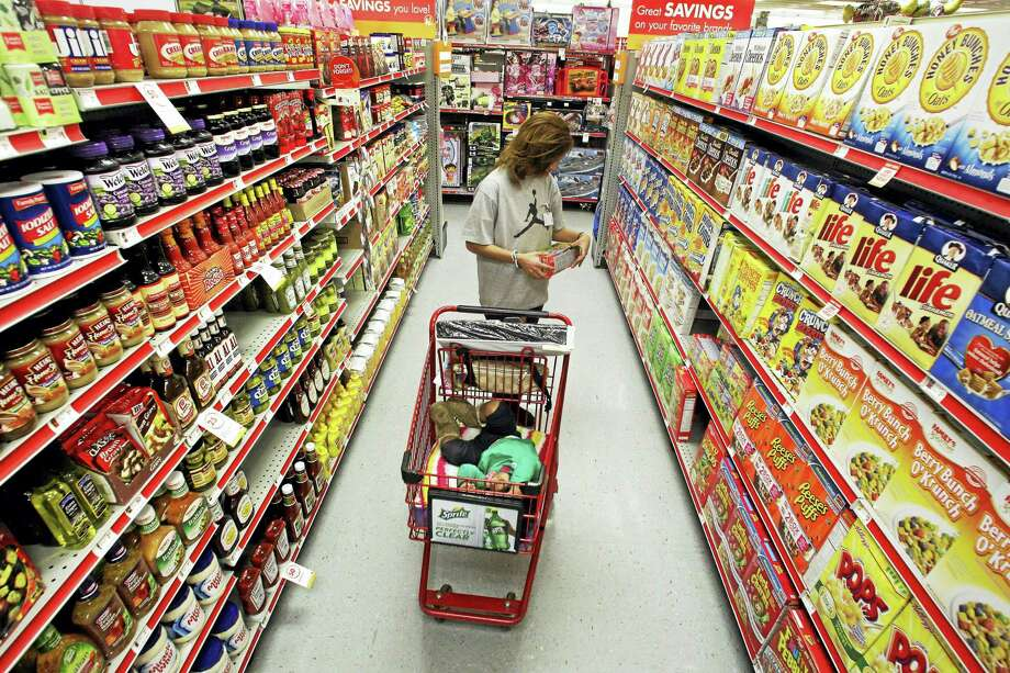 In this 2010 photo, Alicia Ortiz shops through the cereal aisle as her daughter Aaliyah Garcia catches a short nap in the shopping cart at a Family Dollar store in Waco, Texas. Photo: Tony Gutierrez — The Associated Press File Photo   / AP2010