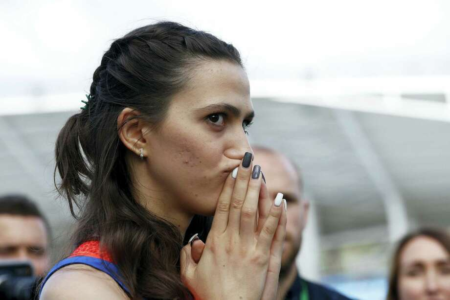 Russia's Maria Kuchina speaks to the press during the Russian Athletics Cup, at Zhukovsky, outside Moscow, Russia on July 21, 2016. Russia lost its appeal Thursday against the Olympic ban on its track and field athletes, a decision which could add pressure on the IOC to exclude the country entirely from next month's games in Rio de Janeiro. Photo: AP Photo/Alexander Zemlianichenko   / Copyright 2016 The Associated Press. All rights reserved. This material may not be published, broadcast, rewritten or redistribu
