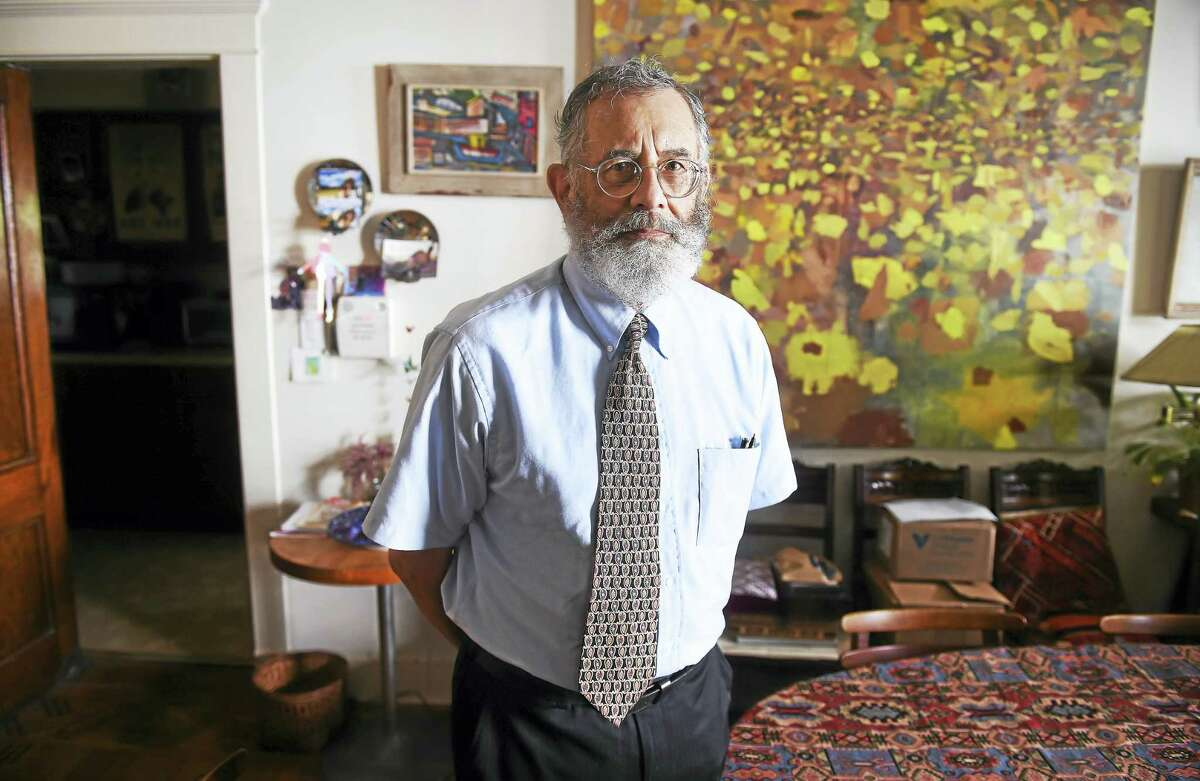 Henry Lowendorf, co-chairman of the Greater New Haven chapter of the U.S. Peace Council, is photographed at his home in New Haven.