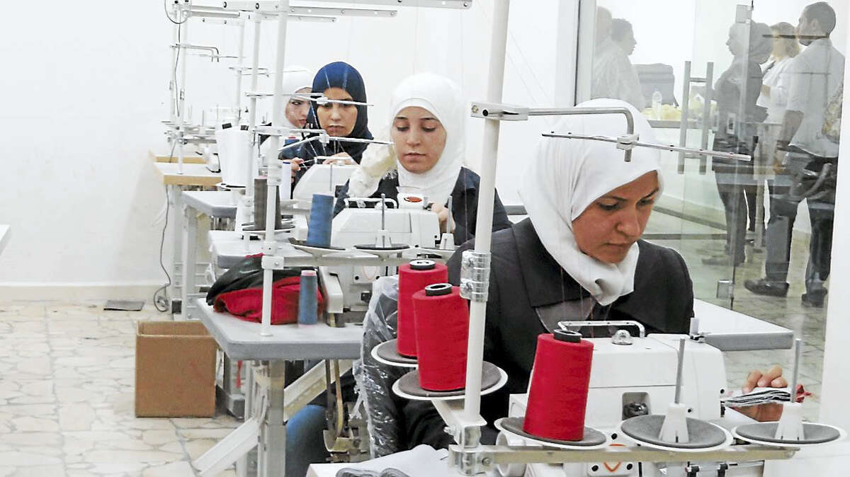 Syrian women learn to sew in Damascus, Syria, at classes offered by an NGO called Syrian Trust for Development.