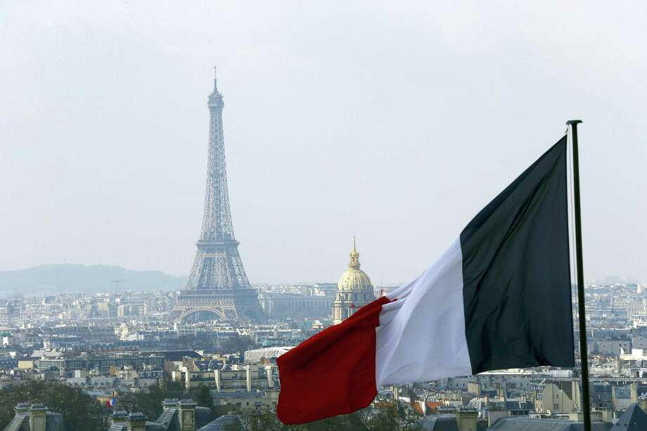 In this April 1, 2016, file photo, the French flag above the skyline of the French capital with the Eiffel Tower, The Invalides Dome and roof tops are seen from the colonnade of the Pantheon Dome in Paris. The Eiffel Tower, normally open every day of every year, is closed Tuesday Dec.13, 2016, because of a strike over salaries and working conditions. Photo: AP Photo/Francois Mori    / AP
