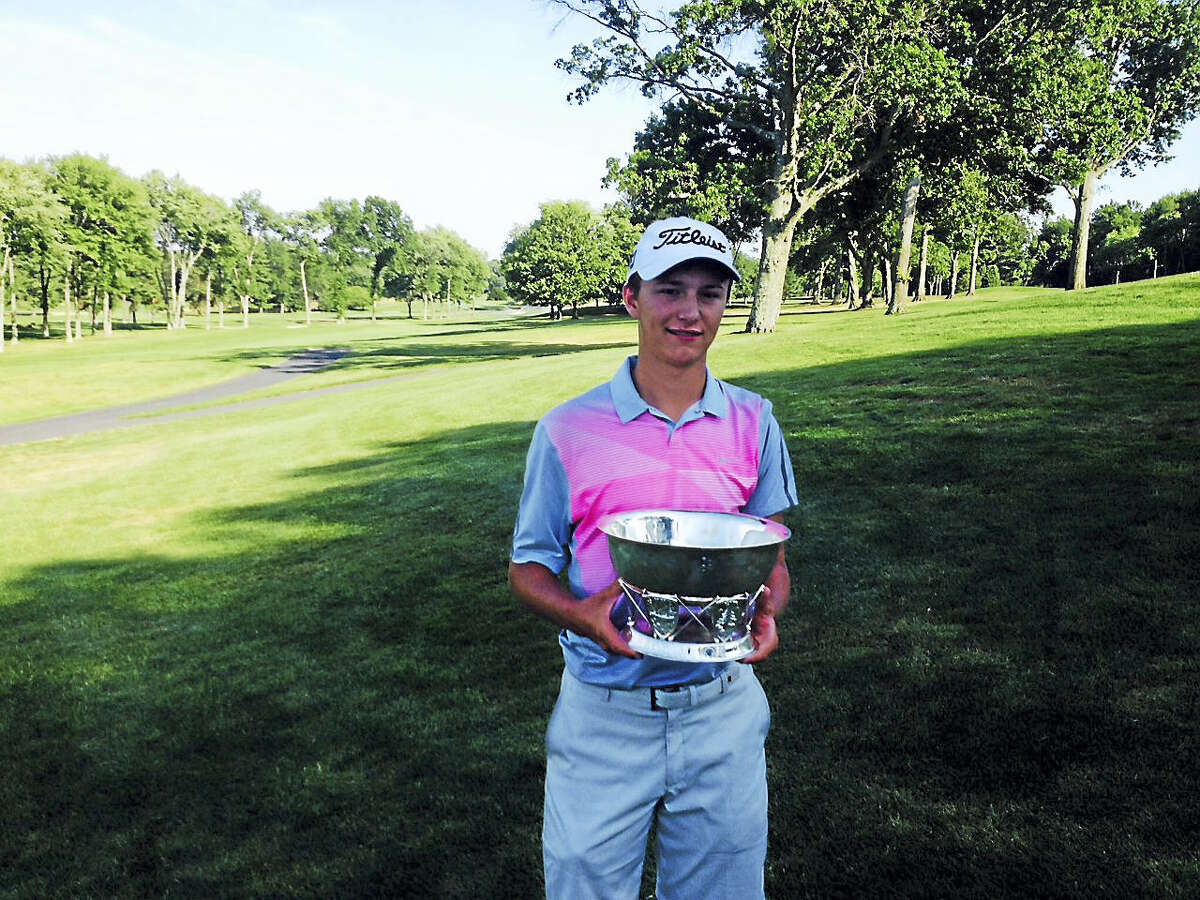 James Turner holds up the championship trophy after winning the 87th New England Amateur at The Hartford Golf Club.