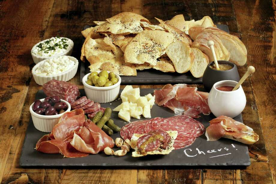 A charcuterie platter with sweet and sharp mustard is an easy and impressive appetizer. Photo: Richard Drew — The Associated Press   / AP