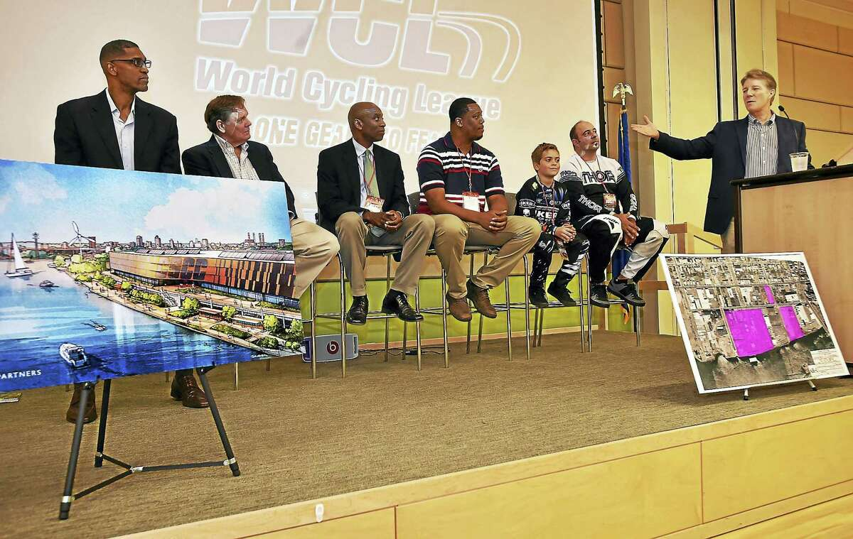 Yale graduate and lifelong cyclist Rick Mayer, right, one of the founders of The Everybody Plays Foundation, unveils the Centric Sports & Cycling Center to be built in Fair Haven. From left are former NBA player Charles Smith; two-time Olympic cyclist Dave Chauner; Keith McDermott, director of the Reggie Lewis Track & Athletic Center; former Hillhouse High School All-American Glen McFadden; 10-year old BMX rider Zachary Michael Tuohy; and Matt Silvia, UCI Supercross BMX World competitor.