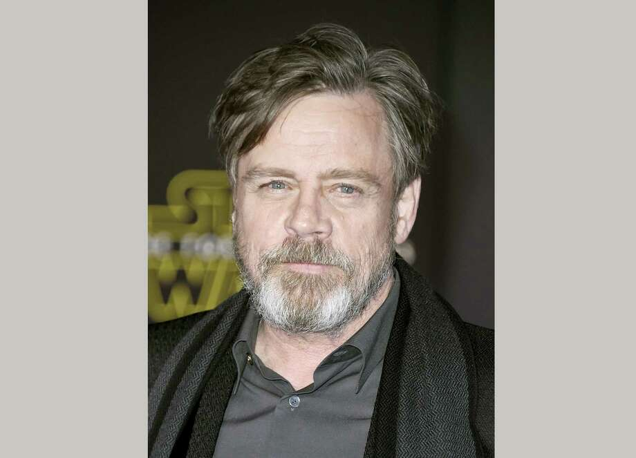 """In this Dec. 14, 2015 photo, Mark Hamill arrives at the world premiere of """"Star Wars: The Force Awakens"""" in Los Angeles. Hamill is lending his support to a terminally ill fan who wants to see """"Rogue One: A Star Wars Story"""" before he dies. Illustrator Neil Hanvey from Oldham, England, was informed by doctors in April that he has six to eight months to live. """"Rogue One"""" is set for release Dec. 16. Photo: Photo By Jordan Strauss/Invision/AP, File   / Invision"""