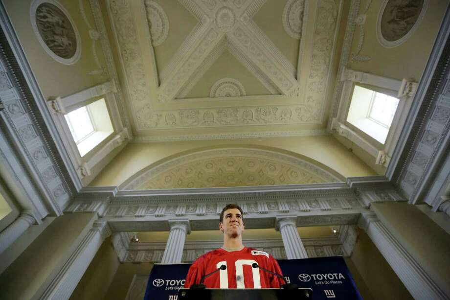 Giants quarterback Eli Manning speaks during a press conference at Syon House in Syon Park, southwest London on Friday. Photo: Matt Dunham — The Associated Press   / Copyright 2016 The Associated Press. All rights reserved. This material may not be published, broadcast, rewritten or redistribu