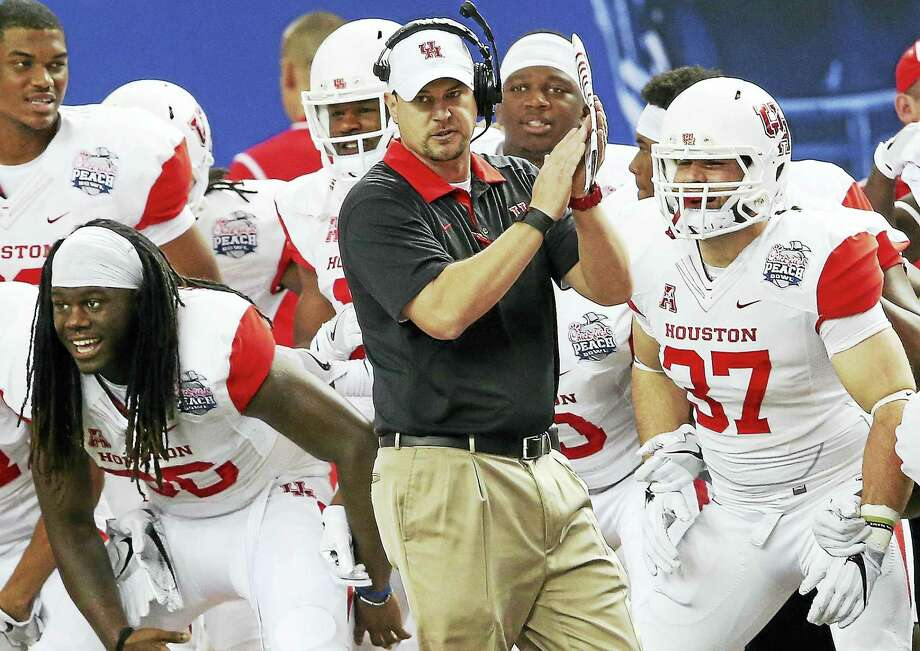 Coach Tom Herman and Houston will look to defend their American Athletic Conference title this season. Photo: John Bazemore — The Associated Press File   / Copyright 2016 The Associated Press. All rights reserved. This material may not be published, broadcast, rewritten or redistribu