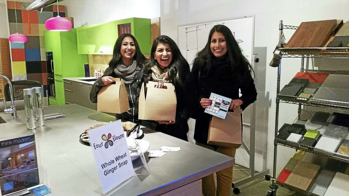 Sisters Huma, Noor and Huda Khalid of Orange bought tickets for the New Haven Cookie Crawl after attending Wine On9.