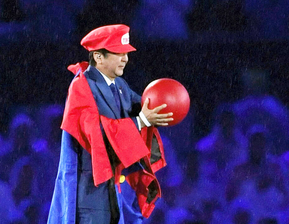 Japanese Prime Minister Shinzo Abe appears as the Nintendo game character Super Mario during the closing ceremony at the 2016 Summer Olympics in Rio de Janeiro, Brazil on Sunday. Abe's brief but show-stopping appearance as Super Mario offered a glimpse at Tokyo's plans for the 2020 games. Photo: Yu Nakajima — Kyodo News Via AP   / Kyodo News