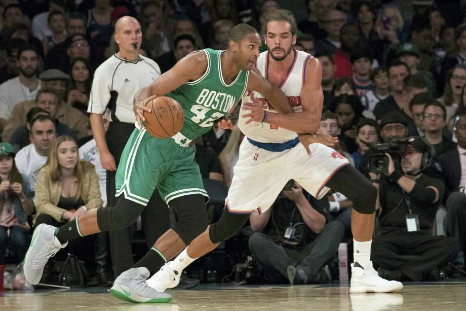 Celtics center Al Horford (42) drives to the basket during a preseason game against the Knicks. Photo: Mary Altaffer — The Associated Press   / Copyright 2016 The Associated Press. All rights reserved.