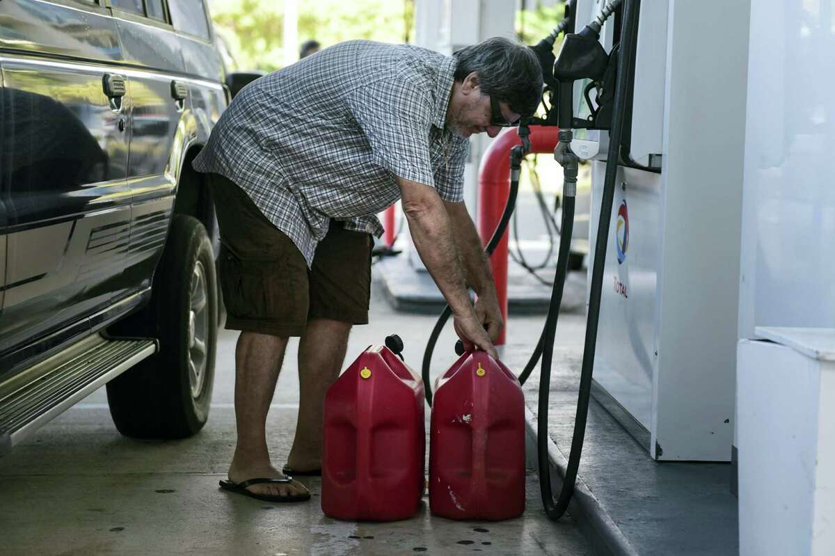 Edgardo Colon picks up his gas container after filling it with diesel for his generator, in San Juan, Puerto Rico on Sept. 22, 2016. Repair crews on Thursday worked to restore electricity to Puerto Rico's 3.5 million people after a fire at a power plant on Wednesday afternoon blacked out the entire U.S. territory.