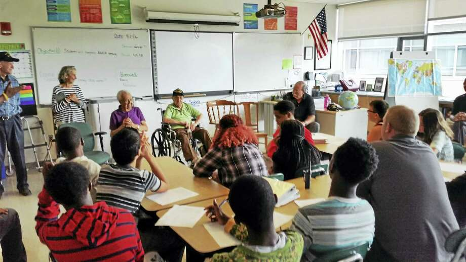 Hamden veterans speak to Hamden Middle School students Wednesday. Photo: Kate Ramunni — New Haven Register