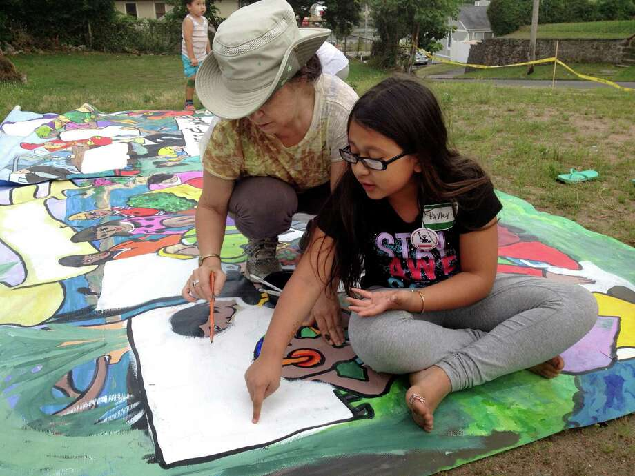Hayley Chavarria, 9, the youngest child of Nury Chavarria, works on a mural prior to a vigil held on Sunday, July 23, 2017, at Iglesia de Dios Pentecostal Church in New Haven, Conn. Nury Chavarria, who was supposed to be deported to Guatemala, has taken sanctuary at the church where she awaits her fate as the community rallies behind her. Photo: Brian Zahn / Hearst Connecticut Media / New Haven Register