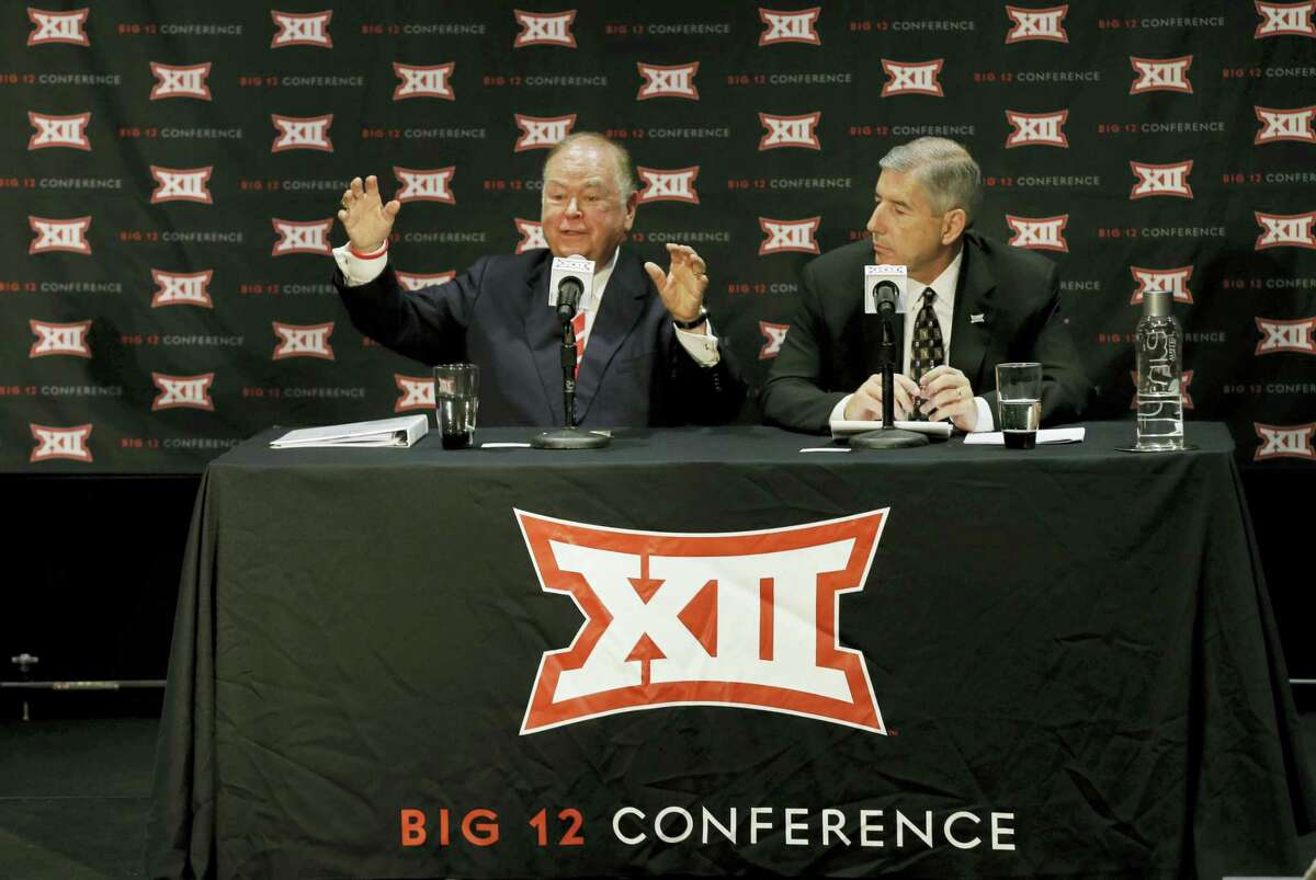Oklahoma President David Boren, left, speaks as Big 12 Commissioner Bob Bowlsby looks on during a news conference earlier this month to announce that the conference had decided to pass on expansion.