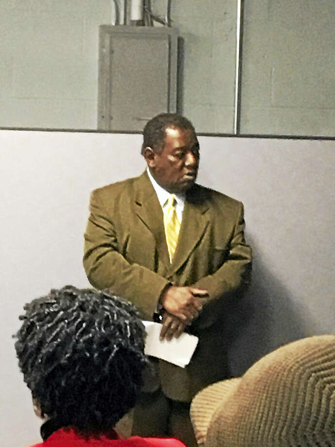 Juan Scott, chairman of the Commission on Equal Opportunities, leads the program on helping small contractors get part of the Strong School work Tuesday night. Photo: MARY O'LEARY — NEW HAVEN REGISTER
