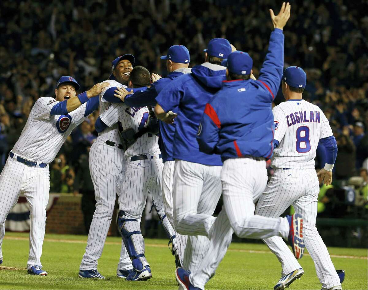 Chicago Cubs players celebrate after winning the NLCS on Saturday night.