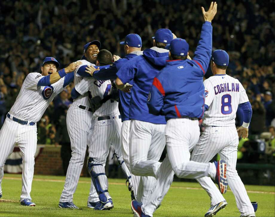 Chicago Cubs players celebrate after winning the NLCS on Saturday night. Photo: Nam Y. Huh — The Associated Press   / Copyright 2016 The Associated Press. All rights reserved.