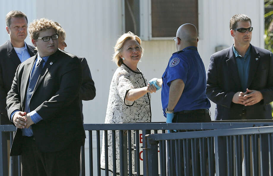Democratic presidential candidate Hillary Clinton greets people as she arrives at Provincetown Municipal Airport in Provincetown, Mass. on Aug. 21, 2016. Clinton is traveling to a fundraiser at the Pilgrim Monument and Provincetown Museum in Provincetown. Photo: AP Photo/Carolyn Kaster   / Copyright 2016 The Associated Press. All rights reserved. This material may not be published, broadcast, rewritten or redistribu