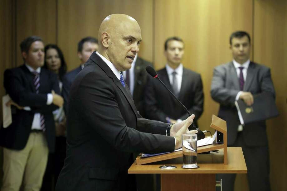 """Brazil's Justice Minister Alexandre de Moraes , speaks on the arrest of 10 people who allegedly pledged allegiance to the Islamic State group on social media and discussed possible attacks during the Rio de Janeiro Olympics, at the Ministry of Justice, in Brasilia, Brazil. However """"they were complete amateurs and ill-prepared"""" to actually launch an attack, Moraes said. """"A few days ago they said they should start practicing martial arts, for example."""" Moraes says two more suspects are being sought. Photo: AP Photo — Eraldo Peres / Copyright 2016 The Associated Press. All rights reserved. This material may not be published, broadcast, rewritten or redistribu"""
