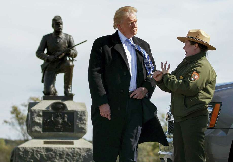 Interpretive park ranger Caitlin Kostic speaks to Republican presidential candidate Donald Trump as she gives him a tour at Gettysburg National Military Park Saturday, Oct. 22, 2016, in Gettysburg, Pa. Photo: AP Photo/ Evan Vucci    / Copyright 2016 The Associated Press. All rights reserved.