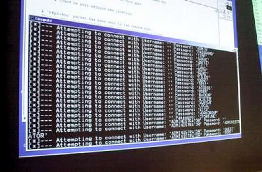 In this Thursday, Jan. 10, 2002, file photo, a computer screen shows a password attack in progress at the Norwich University computer security training program in Northfield, Vt. Photo: AP Photo/Toby Talbot, File    / AP