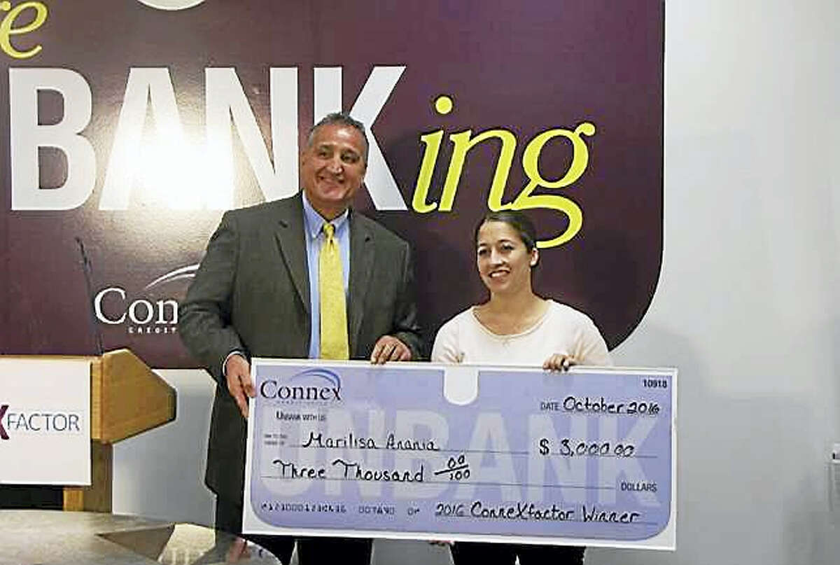 Connex Credit Union President and Chief Executive Officer Frank Mancini, left, presents a check worth $3,000 to 2016 ConneXfactor Grand Prize winner Marilisa Anania of West Haven.