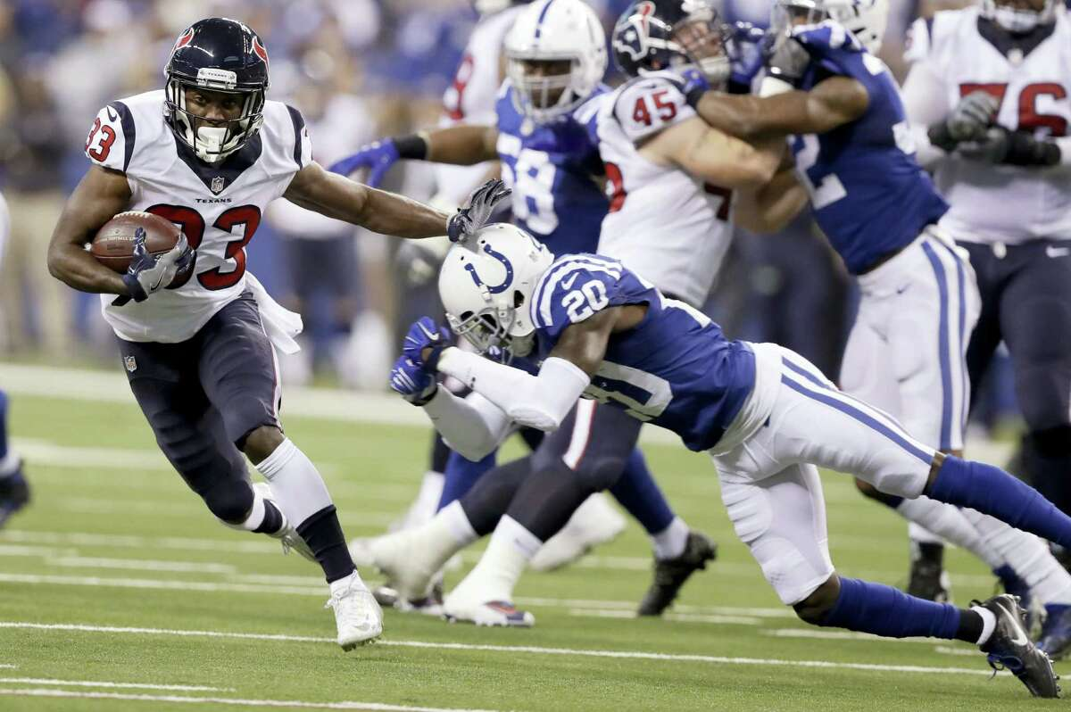 Houston Texans running back Akeem Hunt (33) runs with the ball past Indianapolis Colts cornerback Darius Butler (20) during the first half of an NFL football game Sunday, Dec. 11, 2016 in Indianapolis.