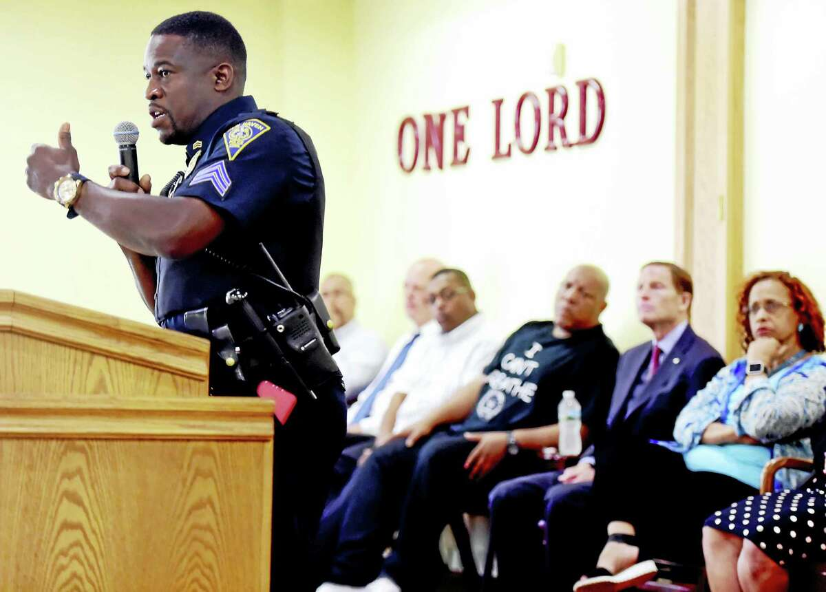 New Haven police Sgt. Shafiq Abdussabur speaks during a Walking While Black community forum Thursday at the First Calvary Baptist Church on Dixwell Avenue in New Haven.