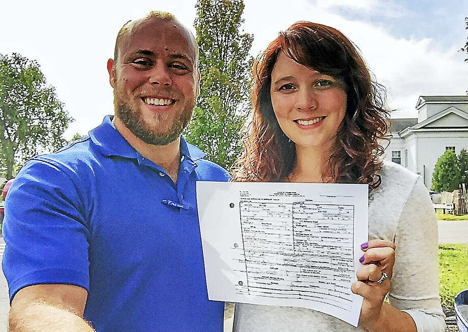 Get Hitched at the Durham Fair contest winners Ken Murphy and Shelby Aiello display the wedding license they received in Durham earlier this week. The couple will wed Sunday at the 97th annual agricultural celebration. Photo: Courtesy Shelby Aiello