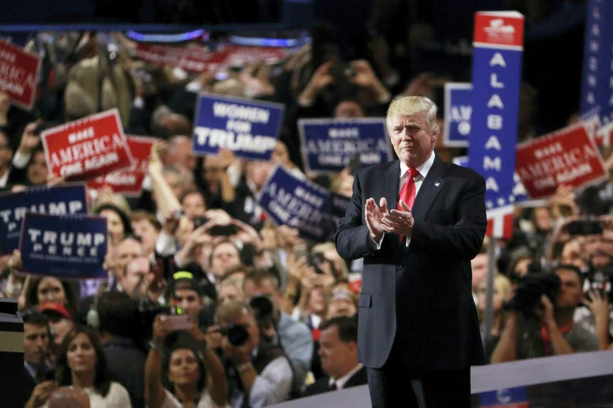 Republican presidential candidate Donald Trump takes the stage during the final day of the Republican National Convention in Cleveland Thursday.