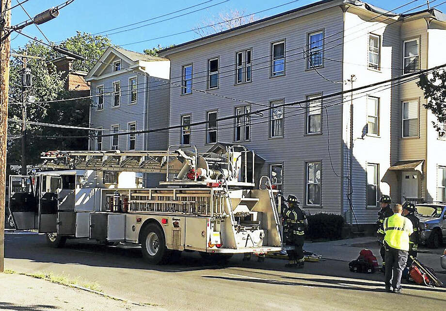 New Haven firefighters battled a kitchen fire early Monday evening at 166 Edgewood Ave. The fire displaced 12 people from the home. Photo: Courtesy Of New Haven Fire Department