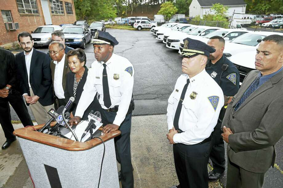 Interim New Haven Police Chief Anthony Campbell (center) talks about the new Dodge Chargers (background right) delivered to the New Haven Police Department Maintenance Facility on 10/21/2016.  They will be customized to function as patrol cars. Photo: Arnold Gold-New Haven Register