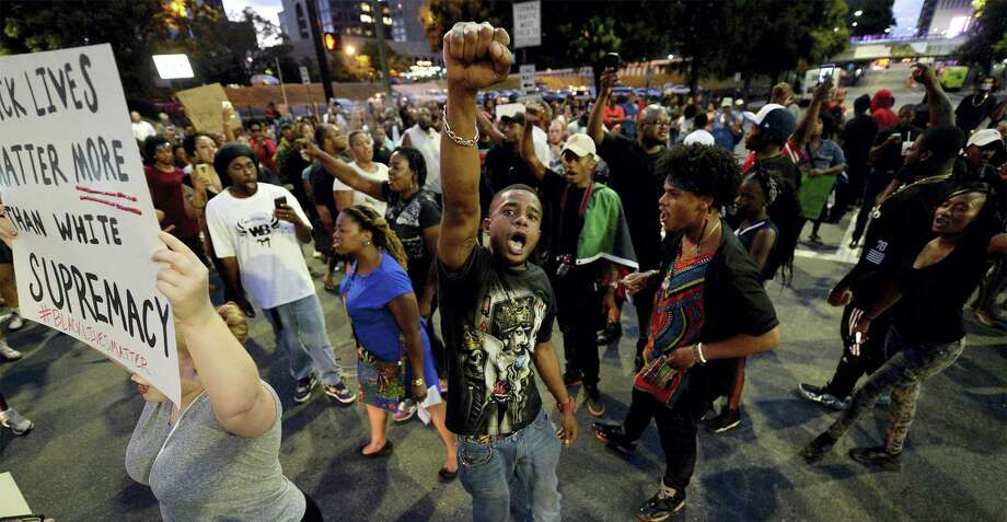 Protesters block an intersection near the Transit Center as they march uptown in Charlotte, N.C., Wednesday. Photo: Jeff Siner — The Charlotte Observer Via AP   / The Charlotte Observer