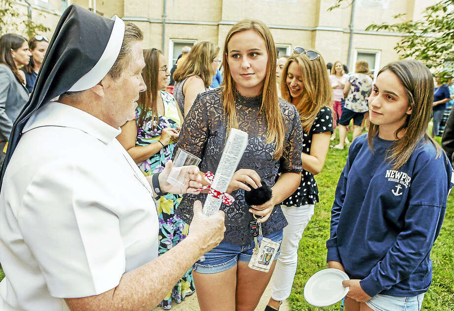JOHN VANACORE — FOR THE REGISTER  New Sacred Heart Academy Principal Sr. Kathleen Mary Coonan talks about the about the upcoming school year with Sacred Heart seniors Kate Napierkowski of Cheshire, center, and Taylor Weiss of West Haven. Photo: Journal Register Co. / John Vanacore/Register