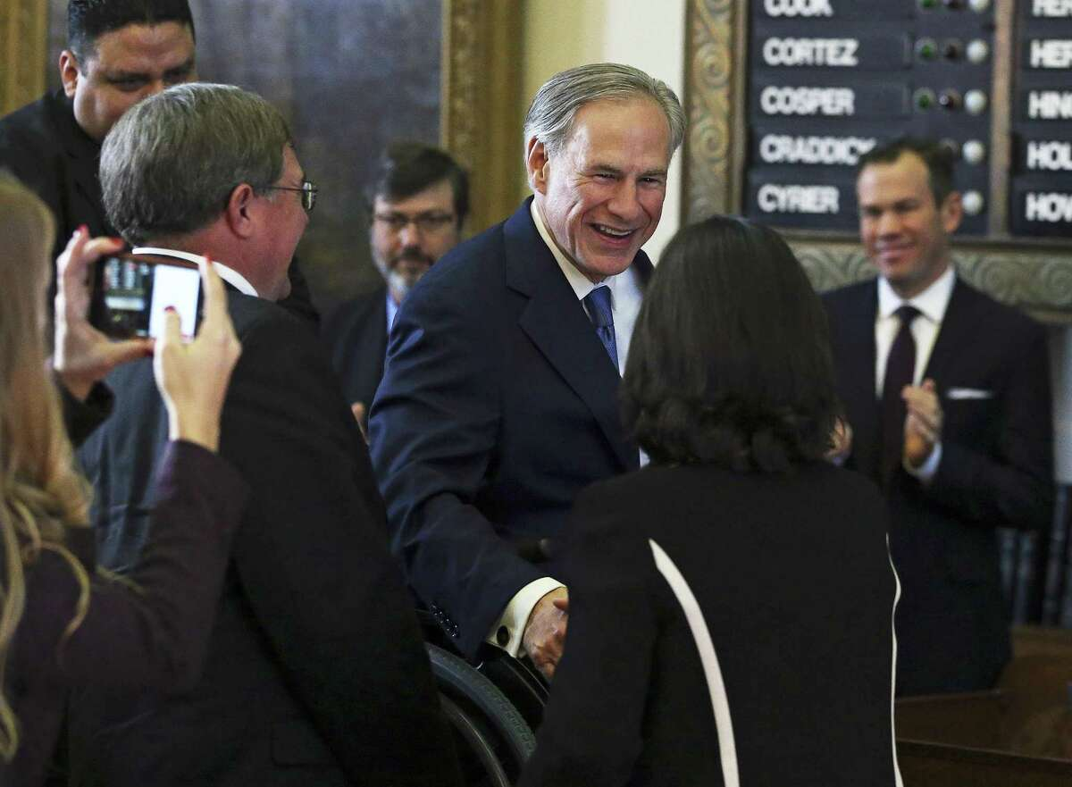 Governor Greg Abbott is greeted as he arrives in the House of Representatives as the 85th Texas Legislative session opens in Austin on January, 10, 2017.