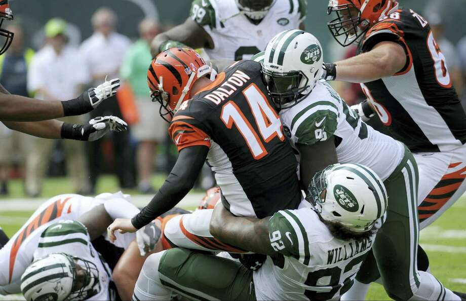 Cincinnati Bengals quarterback Andy Dalton (14) is sacked by the Jets' Leonard Williams (92) and Muhammad Wilkerson (96) during a game earlier this season. Photo: The Associated Press File Photo   / Copyright 2016 The Associated Press. All rights reserved.