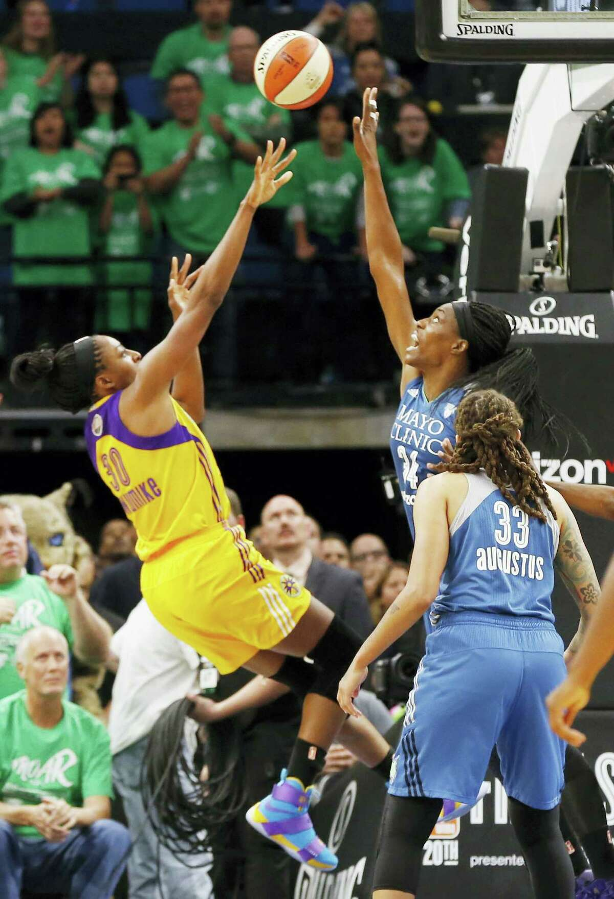 Los Angeles Sparks' Nneka Ogwumike, left, shoots the game wining shot with about 4 seconds left over Minnesota Lynx defender Sylvia Fowles on Thursday.