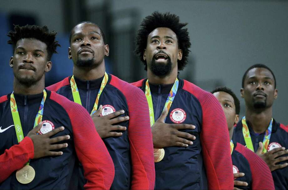 Members of the United States' basketball team stand for the national anthem after accepting their gold medals on Sunday. Photo: Matt York — The Associated Press   / Copyright 2016 The Associated Press. All rights reserved. This material may not be published, broadcast, rewritten or redistribu