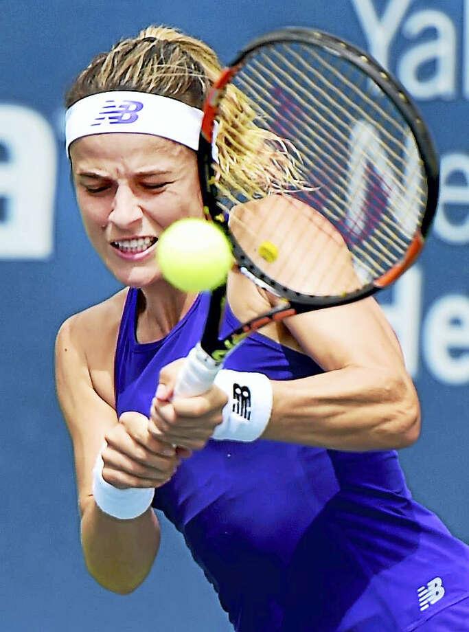 Nicole Gibbs returns a shot Evgeniya Rodina during a qualifying match on Sunday. Photo: Peter Hvizdak — Register   / ?2016 Peter Hvizdak