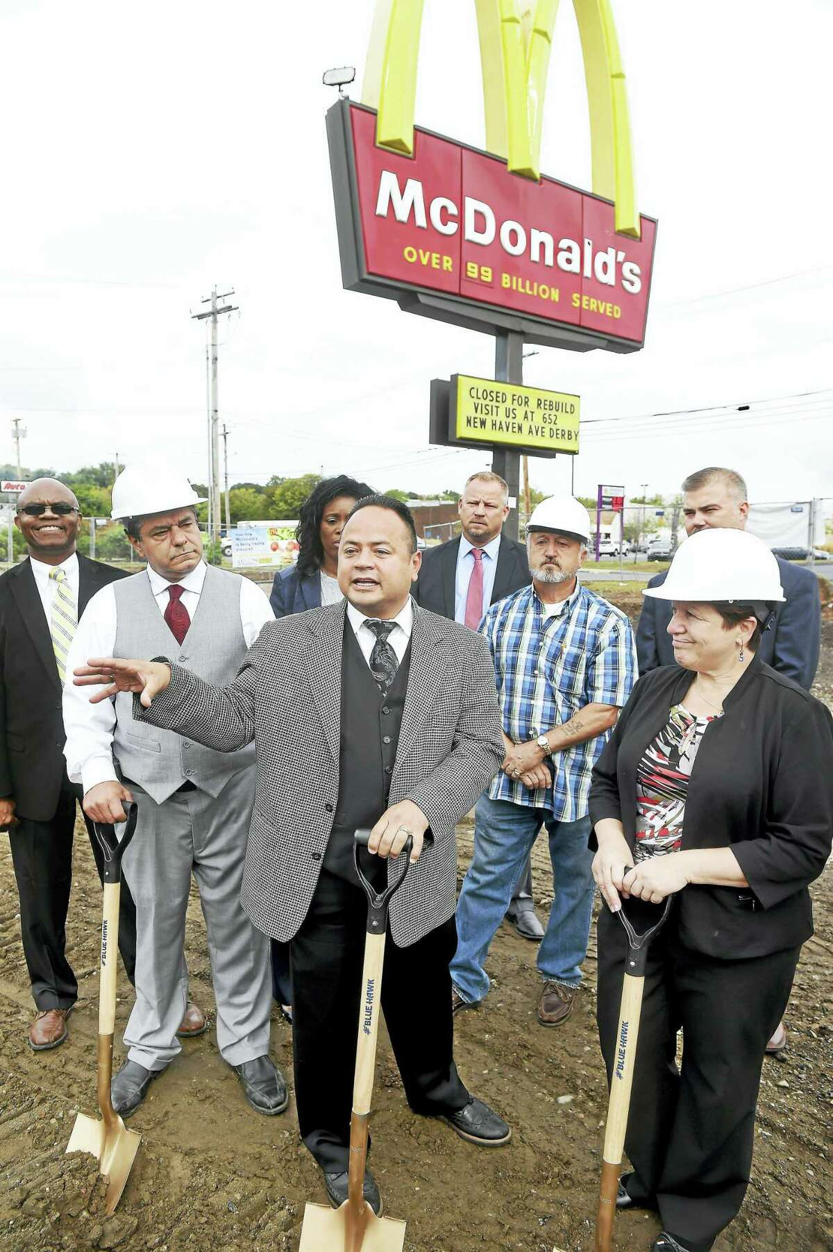 (Arnold Gold-New Haven Register) Left to right in hardhats, Ansonia Mayor David Cassetti, former Derby Mayor Anthony Staffieri and Derby Mayor Anita Dugatto listen to McDonald's owner Joe Rodriguez (center) talk about the new modern and expanded McDonald's being built at this location on Division St. in Derby during a groundbreaking ceremony on 9/27/2016.