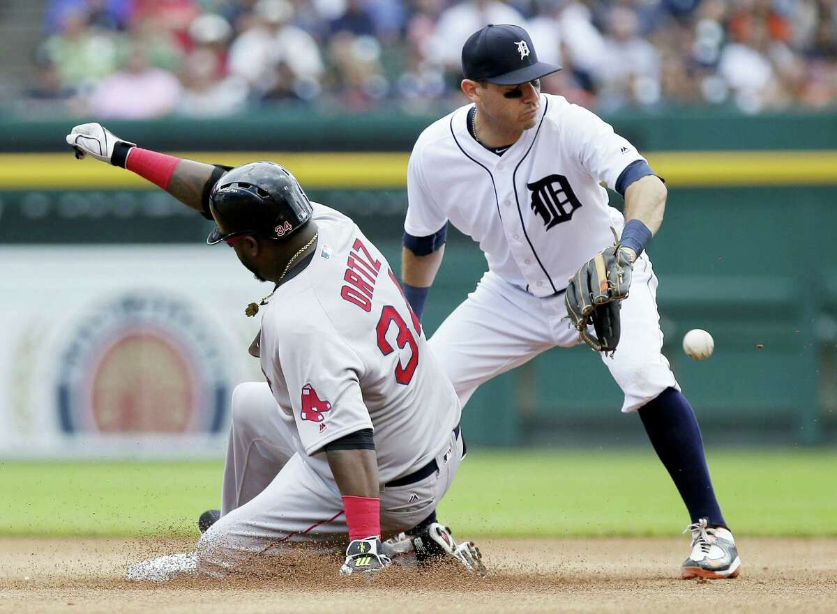 David Ortiz, left, beats the throw to Tigers second baseman Ian Kinsler for a double on Sunday.