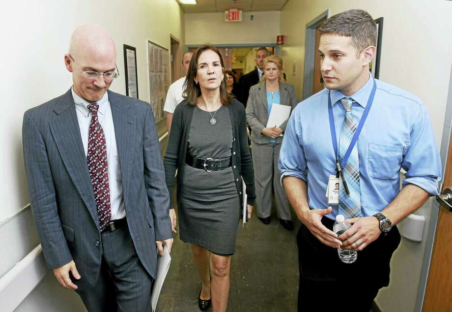 Assistant U.S. Attorney Robert Spector (left) U.S. Attorney Deirdre Daly (center) walk with Benjamin Metcalf (right), program director, South Central Rehabilitation Center, during a tour Tuesday of the center in New Haven. Photo: Arnold Gold — New Haven Register