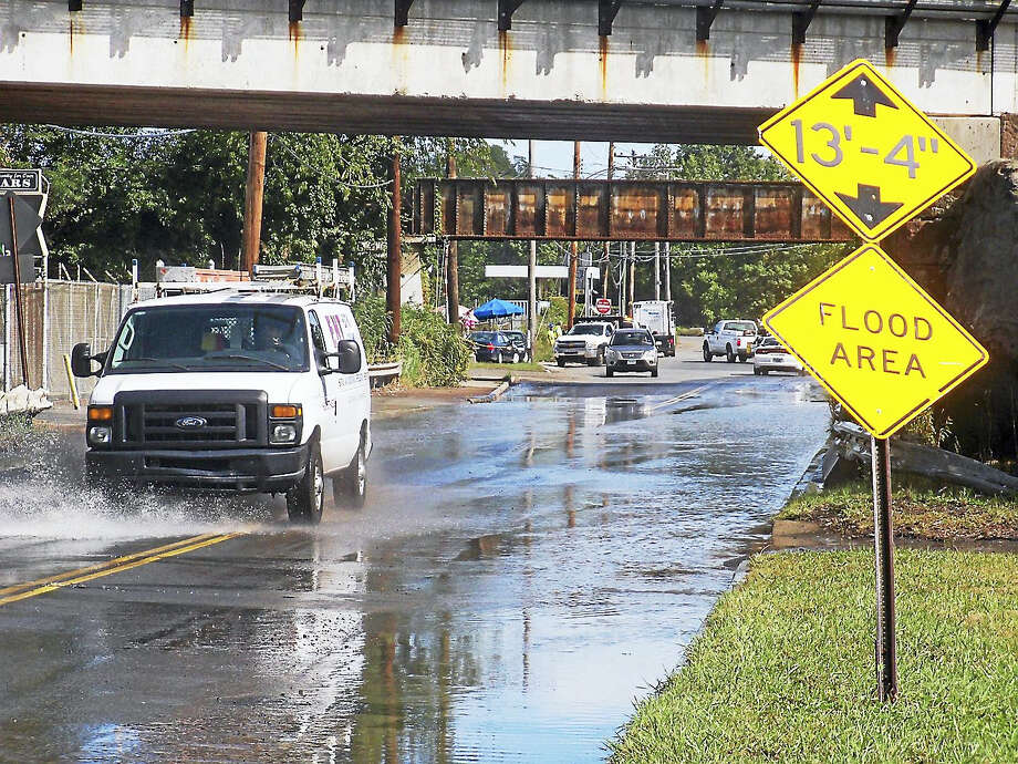 Part of Middletown Avenue in New Haven was partially flooded for about an hour late Wednesday morning after a water main break. Photo: Wes Duplantier—The New Haven Register