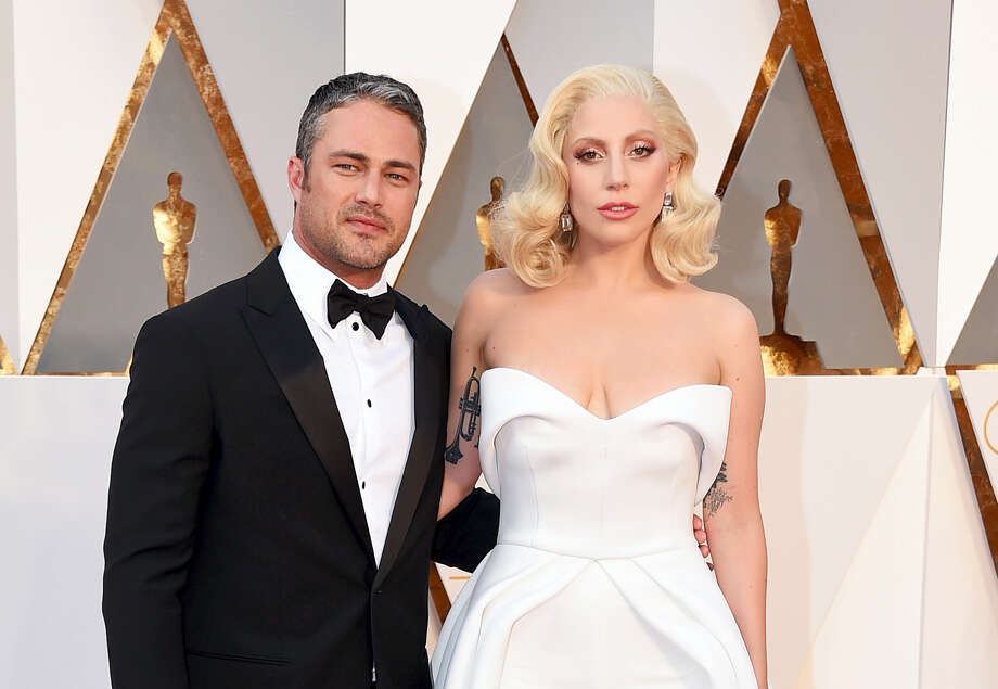 """In this Feb. 28, 2016, file photo, Taylor Kinney, left, and Lady Gaga arrive at the Oscars at the Dolby Theatre in Los Angeles. A representative for the Lady Gaga told The Associated Press on Tuesday, July 19, that the couple is """"taking a break."""" Photo: Photo By Jordan Strauss/Invision/AP, File    / Invision"""