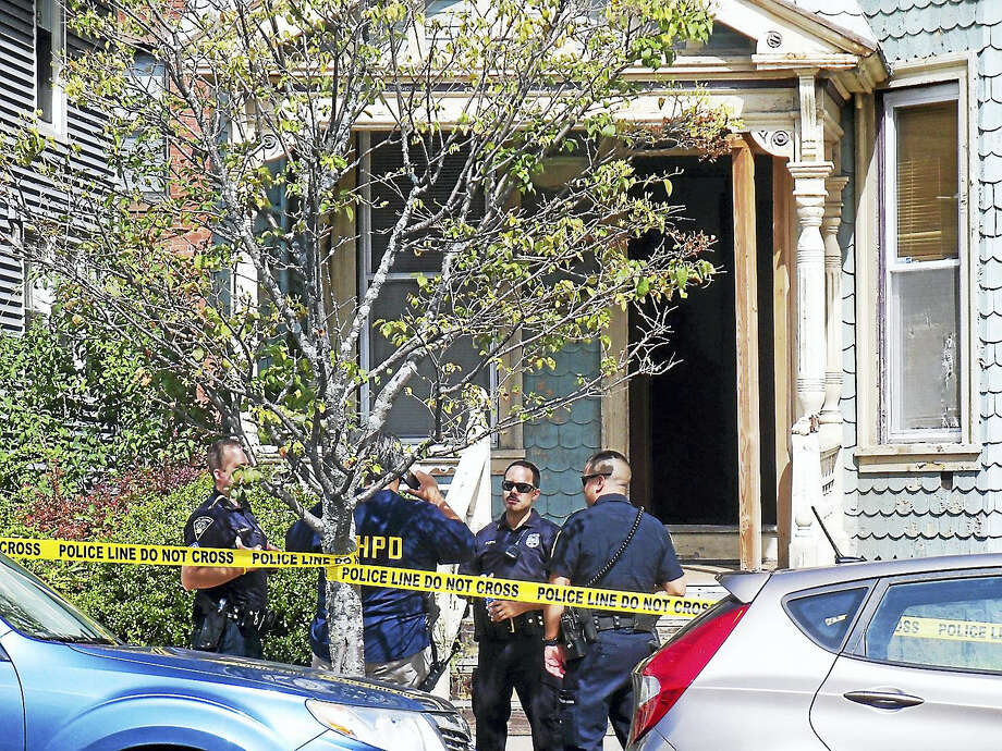 New Haven police were investigating after a man was shot in the leg late Wednesday morning inside a home on George Street. Police say there was some kind of altercation in the house before the man was hurt. Photo: Wes Duplantier—The New Haven Register