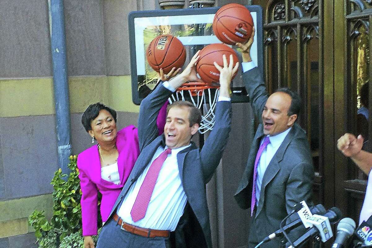 CONTRIBUTED PHOTO — OFFICE OF NEW HAVEN MAYOR TONI HARP From left, New Haven Mayor Toni Harp, Hartford Mayor Luke Bronin and Bridgeport Mayor Joe Ganim join in on a dunk in front of New Haven City Hall Tuesday.