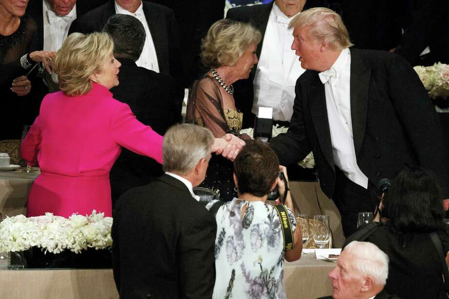 Republican presidential candidate Donald Trump, right, shakes hands with Democratic presidential candidate Hillary Clinton during the Alfred E. Smith Memorial Foundation dinner, Thursday, Oct. 20, 2016, in New York. Photo: AP Photo/ Evan Vucci    / Copyright 2016 The Associated Press. All rights reserved.
