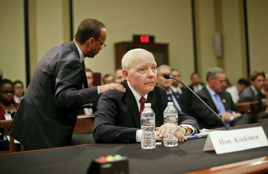 House Judiciary Committee' member Rep. Luis Gutierrez, R-Ill., left, pats IRS Commissioner John Koskinen of the shoulder after questioning Koskinen during the committee's impeachment hearing for Koskinen, on Capitol Hill in Washington. Koskinen expressed regret to Congress for his agency's past mistreatment of tea party groups, but said he has cooperated with congressional investigators and does not deserve to be impeached. Photo: AP Photo/Pablo Martinez Monsivais    / Copyright 2016 The Associated Press. All rights reserved.